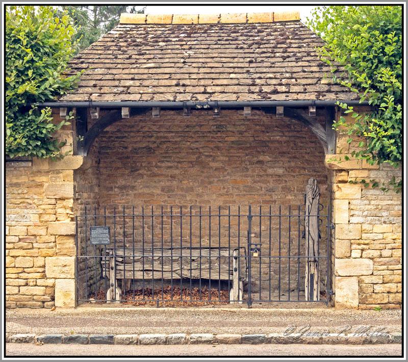 Apethorpe Village Stocks and Whipping Post, Apethorpe, Northamptonshire, England.
